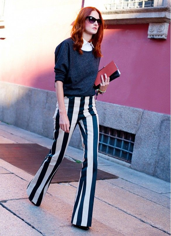 Striped wide legged pants paired with cat-eye sunglasses
