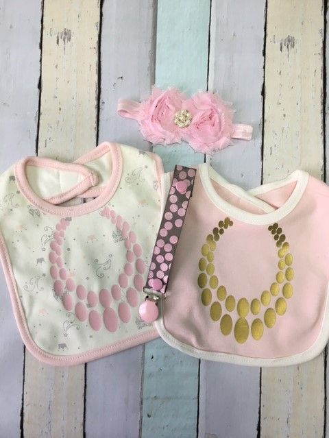 Adorable new baby gift set, two bibs, paci holder and a headband.   from Sassydoodle Baby.