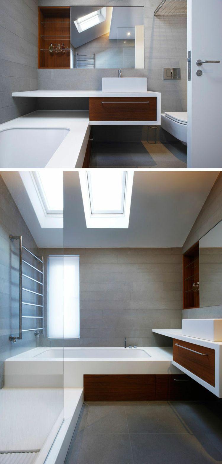 Modernes Badezimmer mit Dachfenstern und Badmöbeln mit elegantem ...