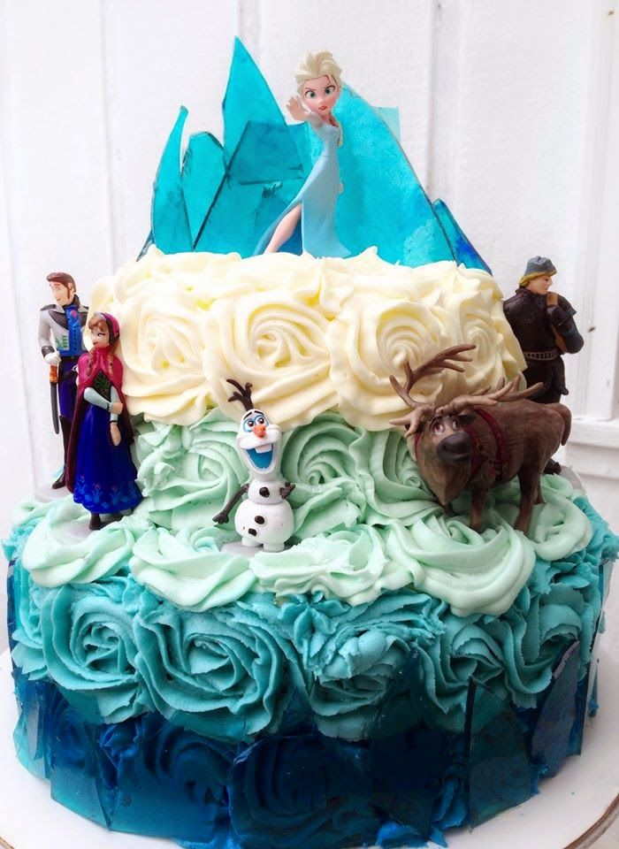 Disneys Frozen Cake Blue ombre buttercream rosettes and broken