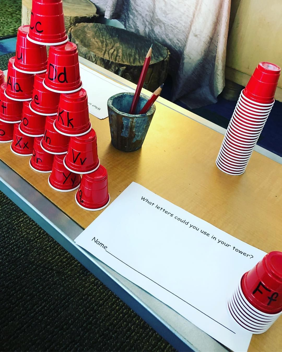 How to play letter stackit you take a cup off the pile