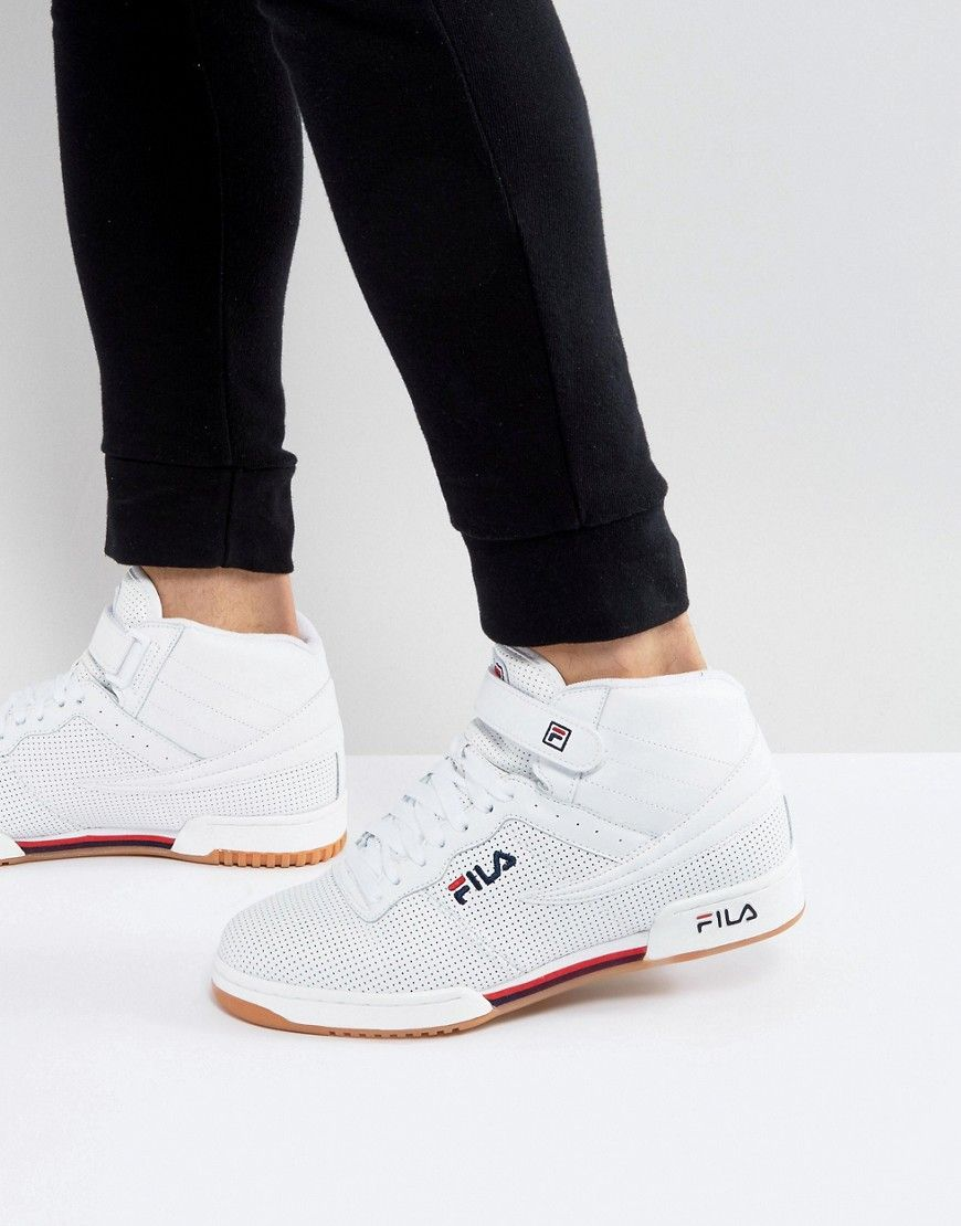 14d3c2ae1eed Get this Fila Vintage s sneakers now! Click for more details. Worldwide  shipping. Fila F13 Perforated Mid Trainers With Strap - White  Trainers by  Fila ...