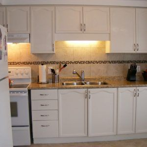 White Plastic Laminate Kitchen Cabinets