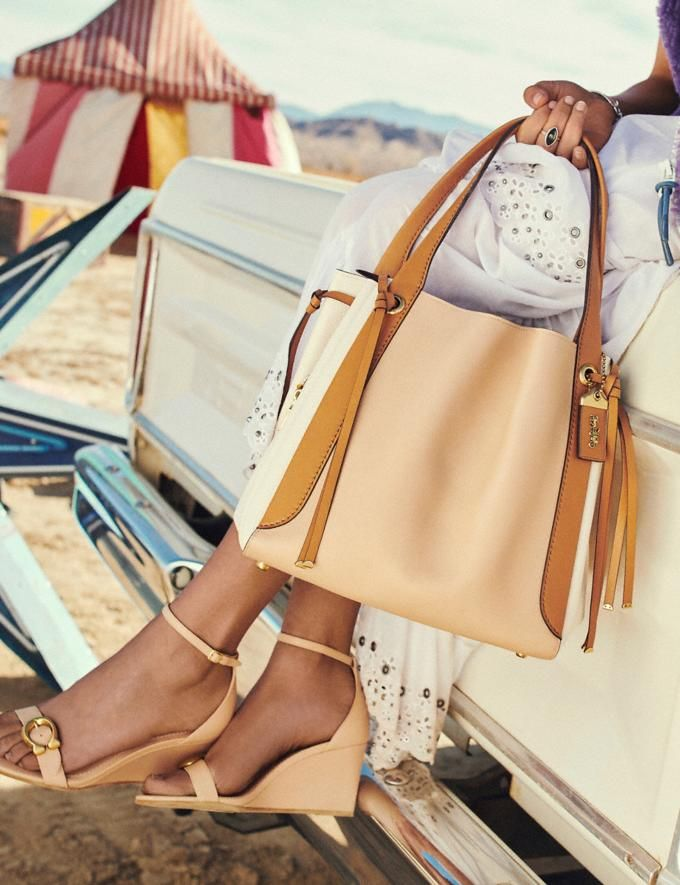 ef9ae38668d9 Find this Pin and more on Pretty Pocketbooks & Snappy Shoes by LME. Harmony  Hobo in Colorblock | COACH