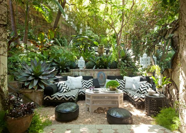 Tropical outdoor living space with black and white and Moroccan elements - Design by: Martyn Lawrence Bullard
