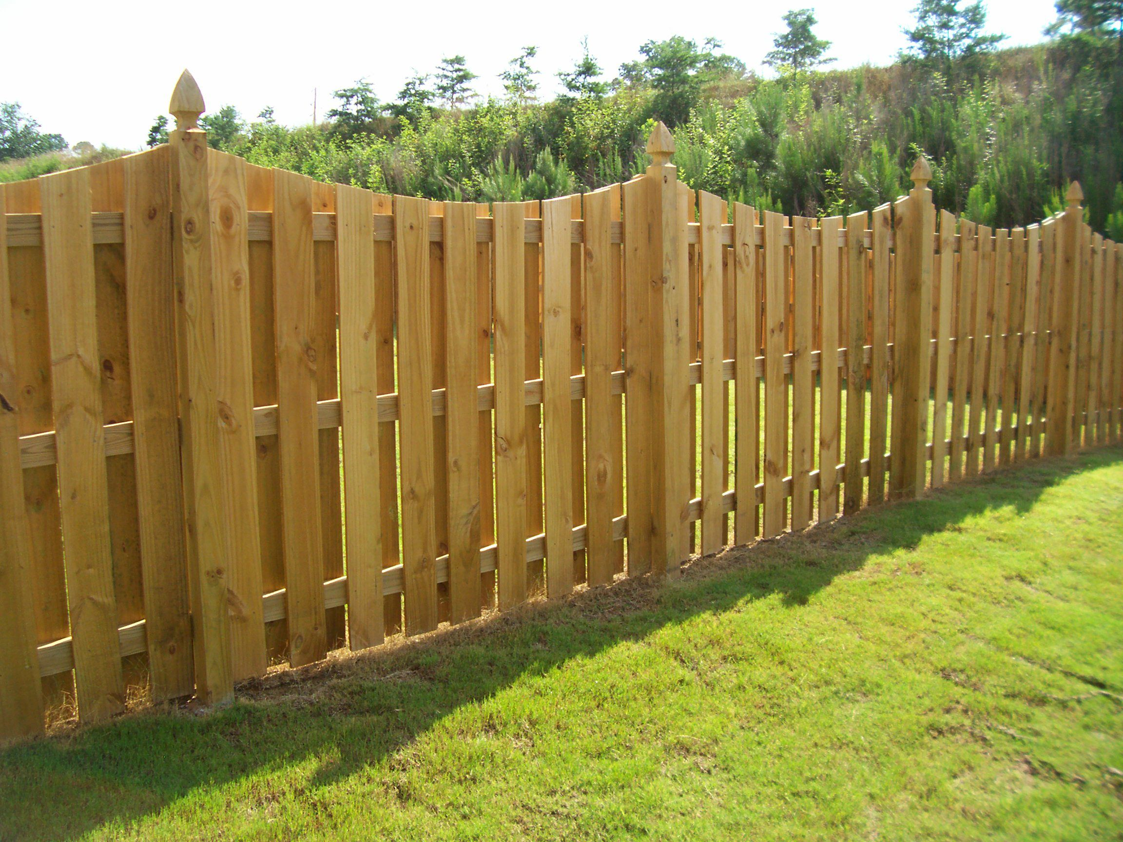 saddle cut wood semi privacy shadowbox fence with gothic posts