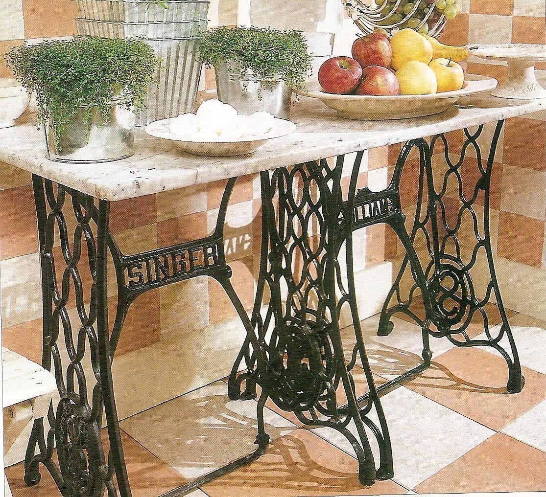 Patas de maquinas de coser,ahora mesas con tapa de mármol