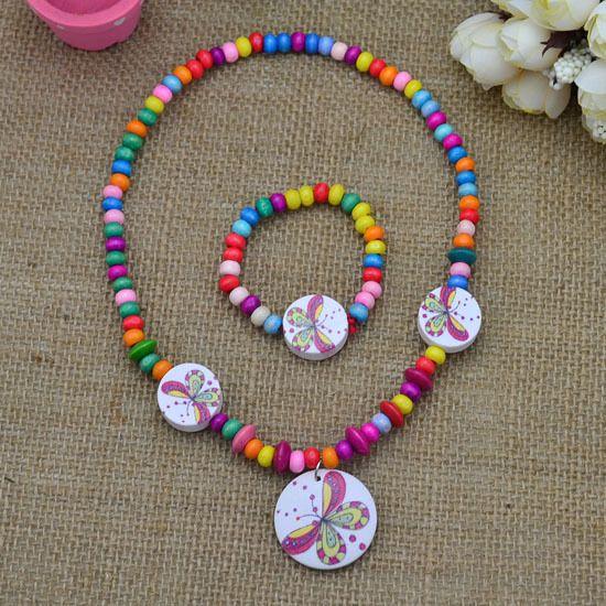 Ensemble de bijoux de nouvel enfant de Mode mignon papillon bois collier bracelet ont cadeau de partie élastique pour les enfants fille gros CS120