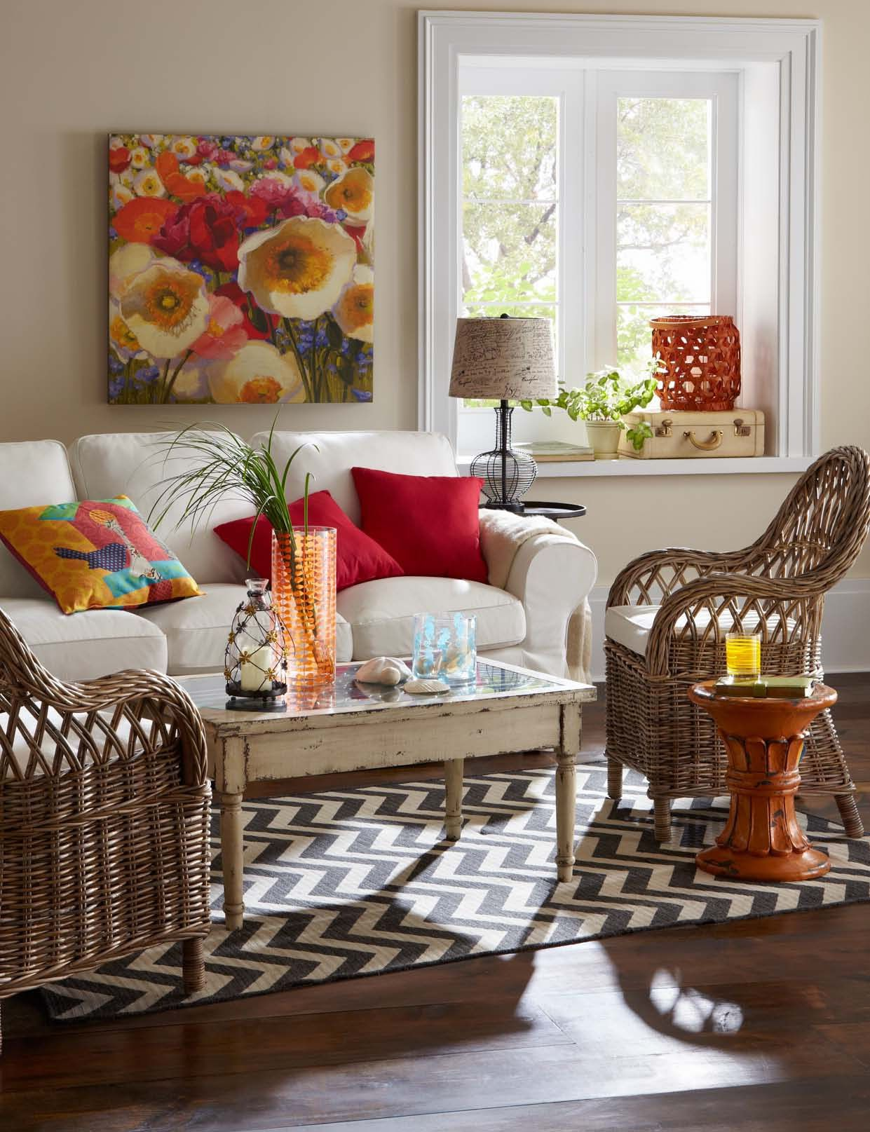 Wake up your room by adding color through accents. Hang artwork that you love and pull colors from it as you select pillows, throws and florals. Anchoring a rug under furniture pieces ties a room together. Shop this room!