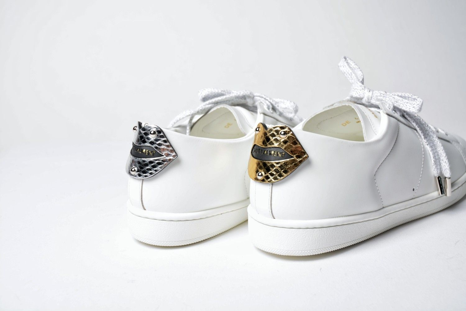 d14a705356b Saint Laurent lips sneaker gold and silver ❤ Ysl white sneaker with lips  details at the back bicolor. SPINNAKER BOUTIQUE.