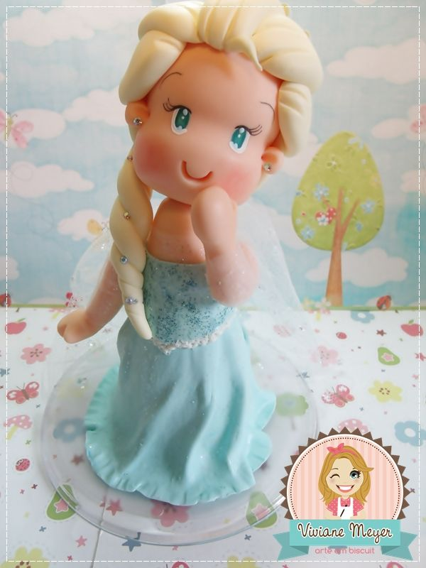 Elsa Frozen topper cake party. http://www.vivianemeyer.com.br/