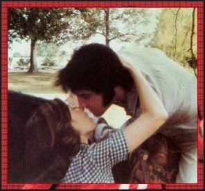 Elvis kissing Priscilla