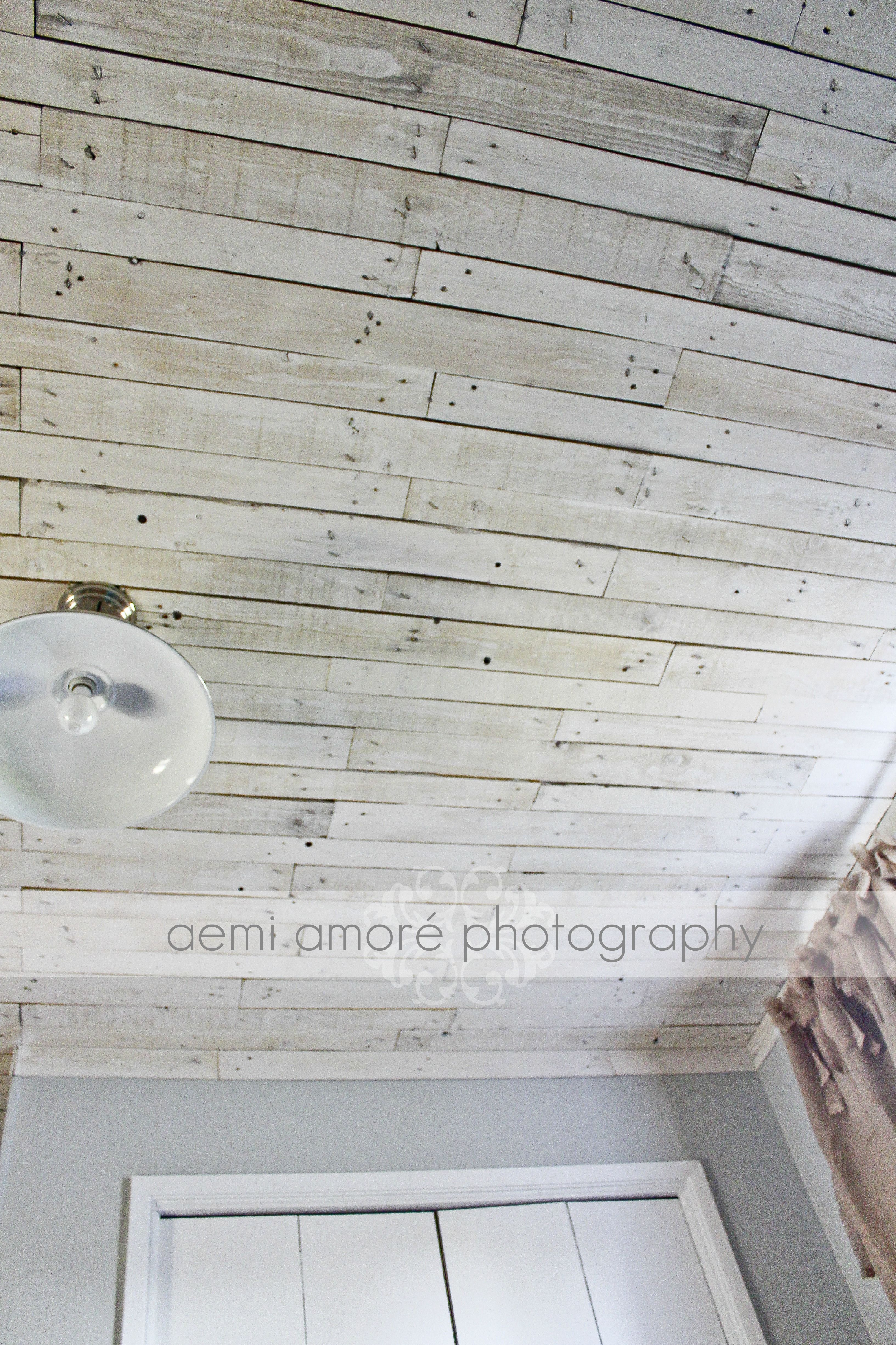 White washed ceiling I made using pallet wood, I added a fun industrial style light from Lowe u0026#39;s