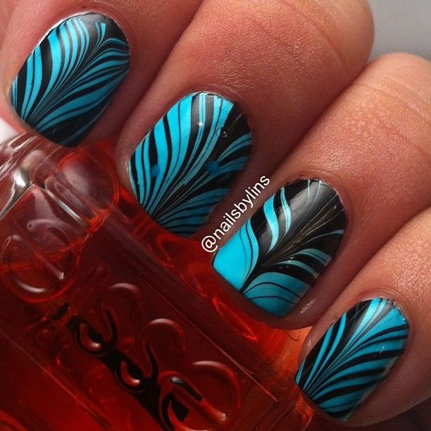 Colors for this water marble: bl slapper and wet wild black creme. - @nailsbylins