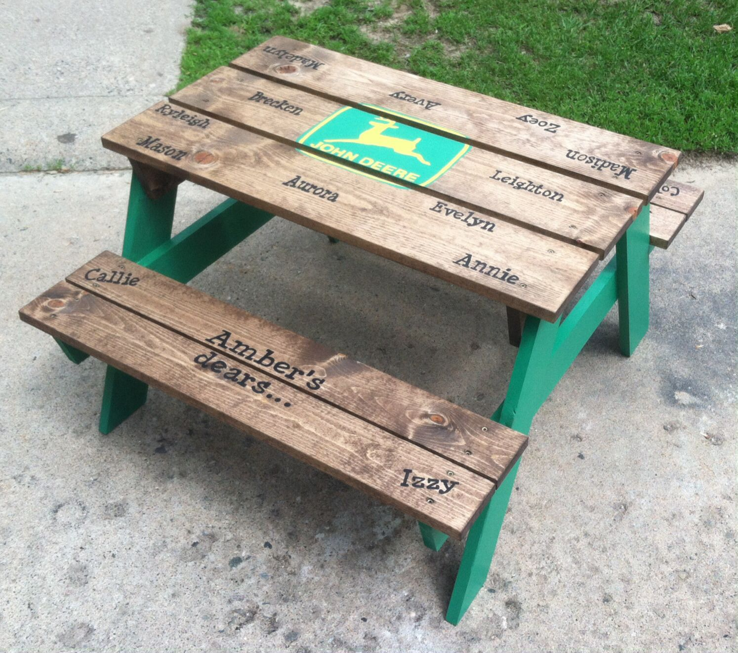 Painted a John Deere themed picnic table for my daycare kiddos