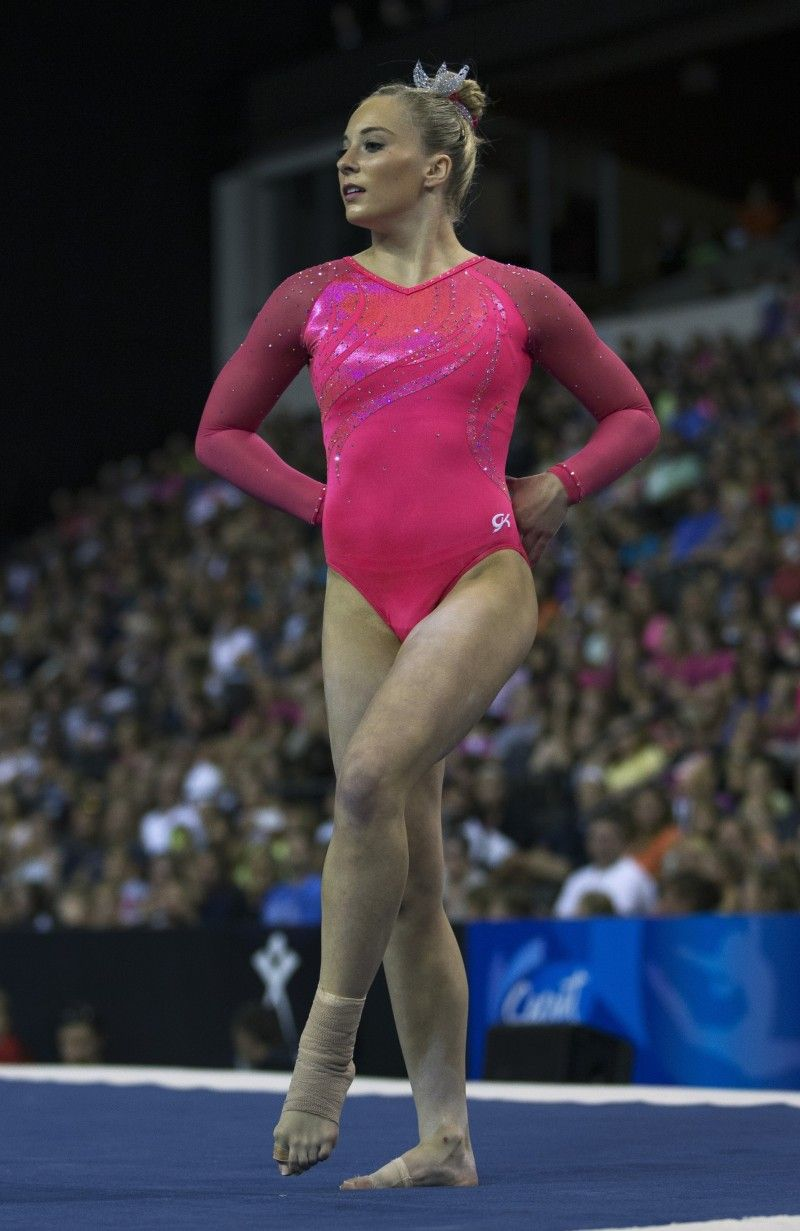 MyKayla Skinner at 2015 US Classic in vibrant pink gymnastics competitive leotard.