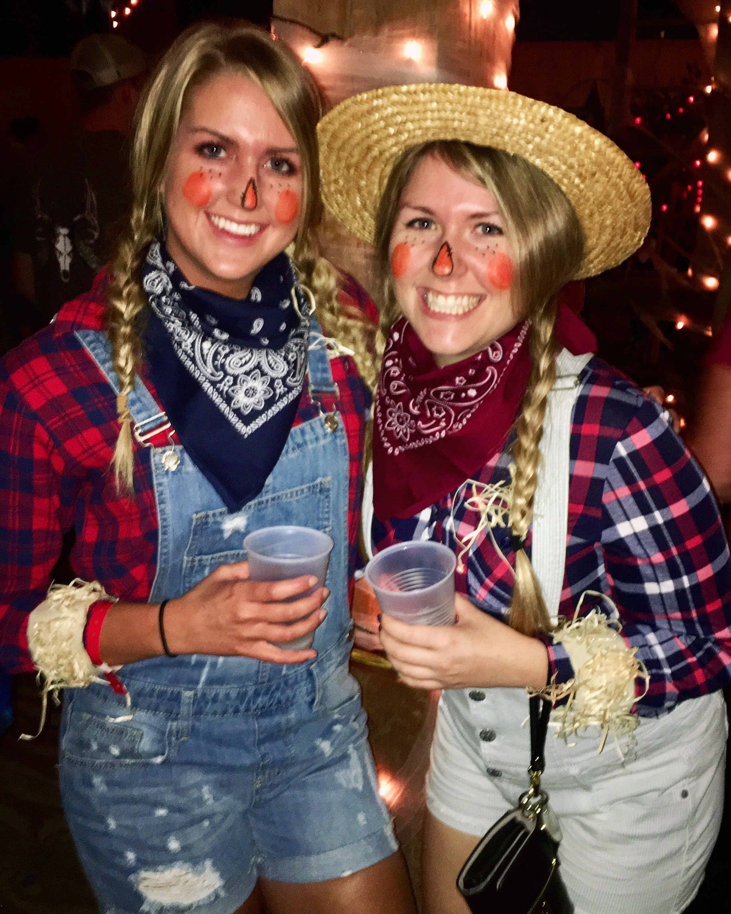Easy scarecrow costume: straw hat, nose and cheek makeup, bandana, overalls, flannel, fake straw hot glued onto ribbon and pinned on sleeves, and cowboy boots #scarecrowcostumediy