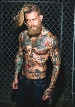 Blonde hair black beard tattoo