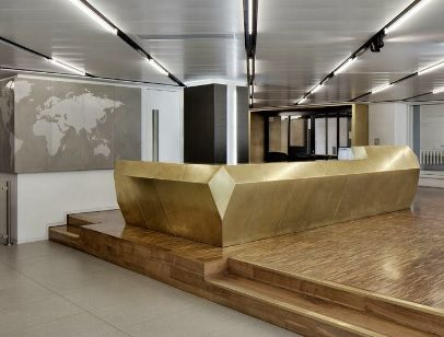 Gold concierge desk inspiration. Possibly curved rather than geometric
