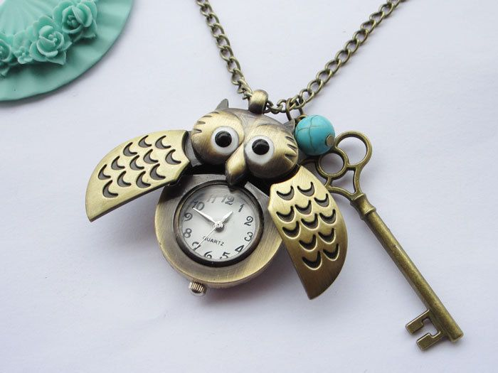 pocket watch--antique bronze owl pocket watch and key,alloy chain necklace. $5.50, via Etsy.