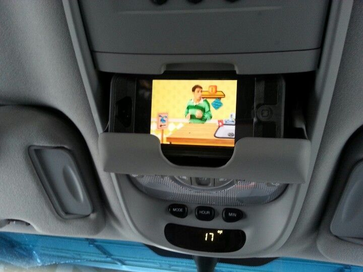 Daddy's iphone as DVD player in sunglass holder in mini-van