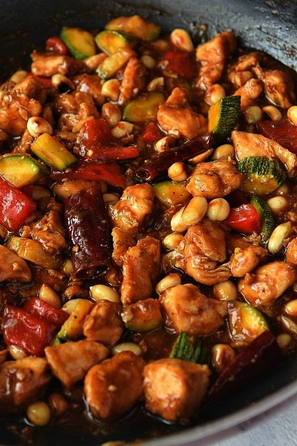 Copycat Kung Pao Chicken  so easy and best recipe of chicken tossed with bell pepperschili peppers zucchini and peanuts in saucesPanda Express Copycat Kung Pao Chicken  s...
