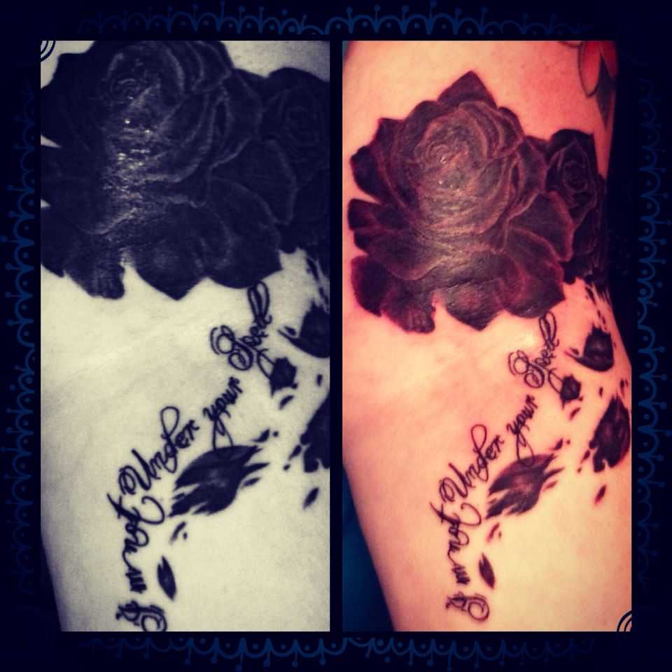 My new tattoo! Black roses crumbling as they are held with the words I'm not under your spell ...
