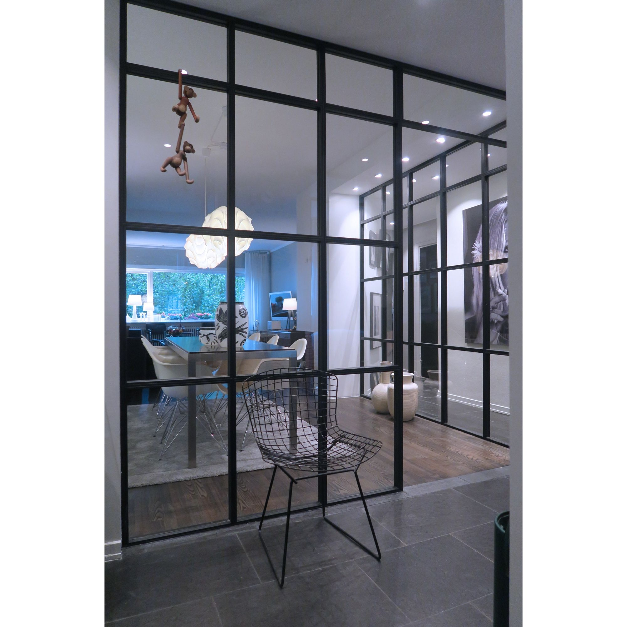 Dividing rooms with steel and glass partitions can bring the…