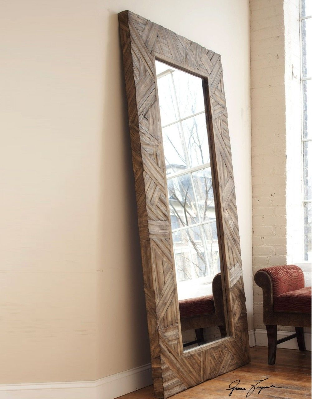 Tehama   Majestic In Height, This Mirror Features A Wood Frame Finished In  Antiqued Light Walnut With Burnished Details. Mirror Features A Generous 1  Bevel.