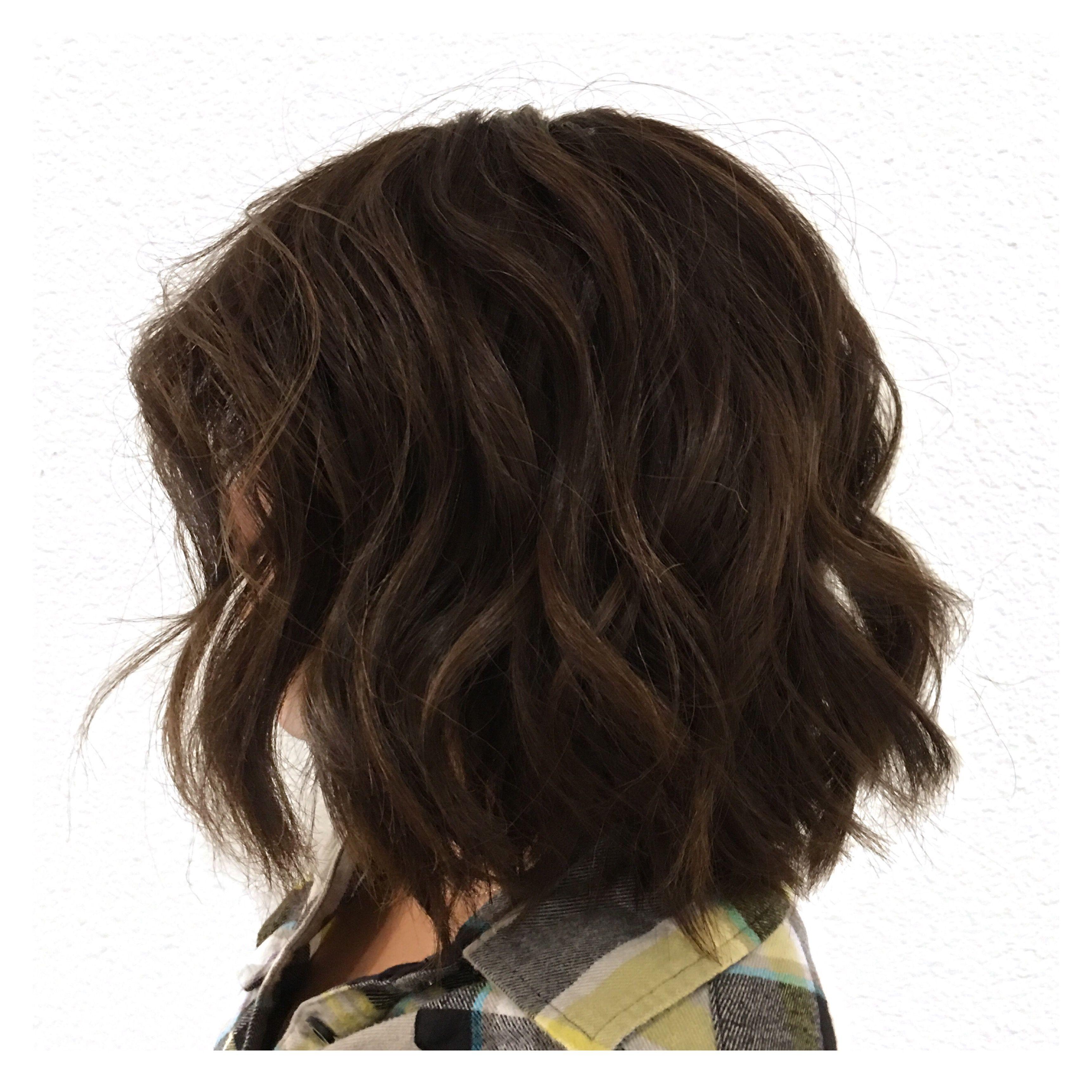 all over dark brown color brunette short haircut lob waves