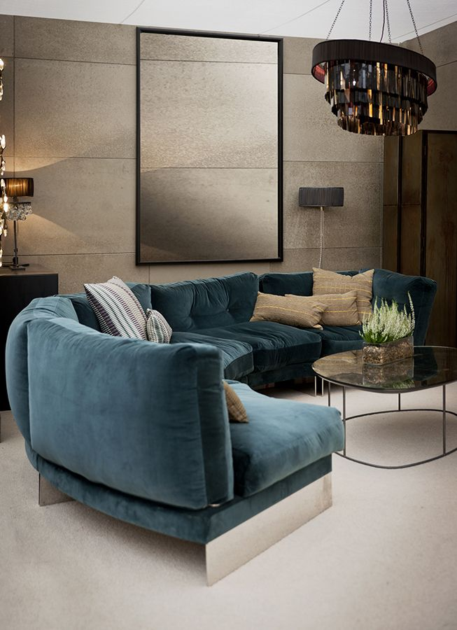 a curved sectional in a fuzzy medium blue perfect for lots of living room seating