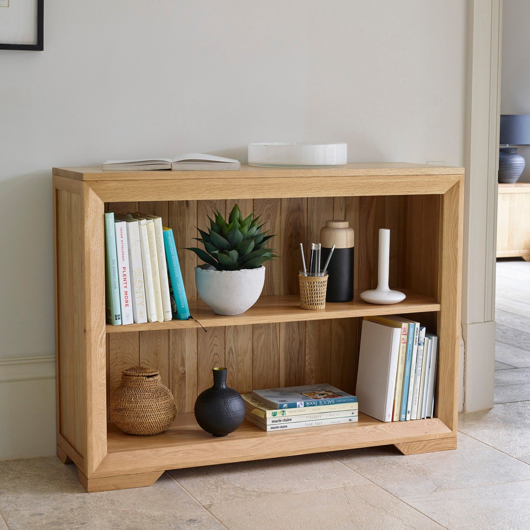 The bevel natural solid oak small bookcase has an exclusive design