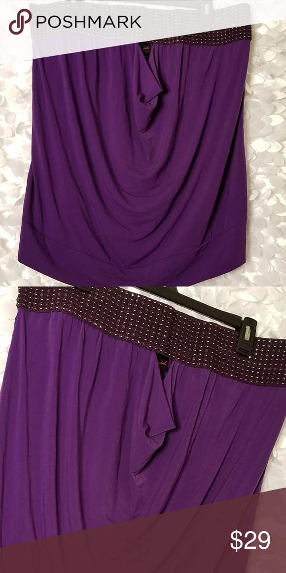 8dcfb313ab0e3 NWT Torrid Purple Keyhole Tube Top Size 2 New with Tag Purple tube top with  silver embellishments throughout band. Width across band 18