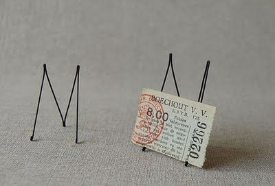 wire stand - would be good for cartouche display