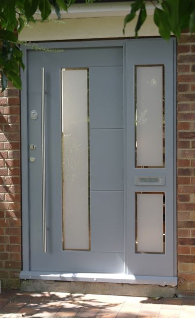 Grey front door with frosted window and etching. Modern design ...