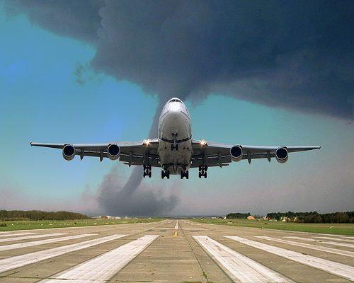 plane landing with a tornado