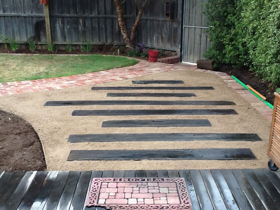 Railway sleepers in granitic gravel for a informal path for Garden designs using railway sleepers