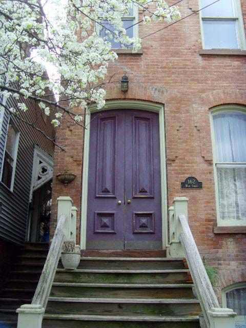 Purple Door With Clay Coloured Brick House May Be The