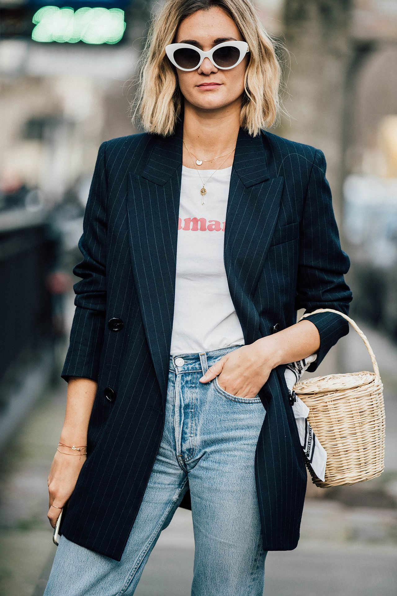 Easy outfit yet so cool. Same white sunglasses. Black blazer. Jeans. Statement tee.
