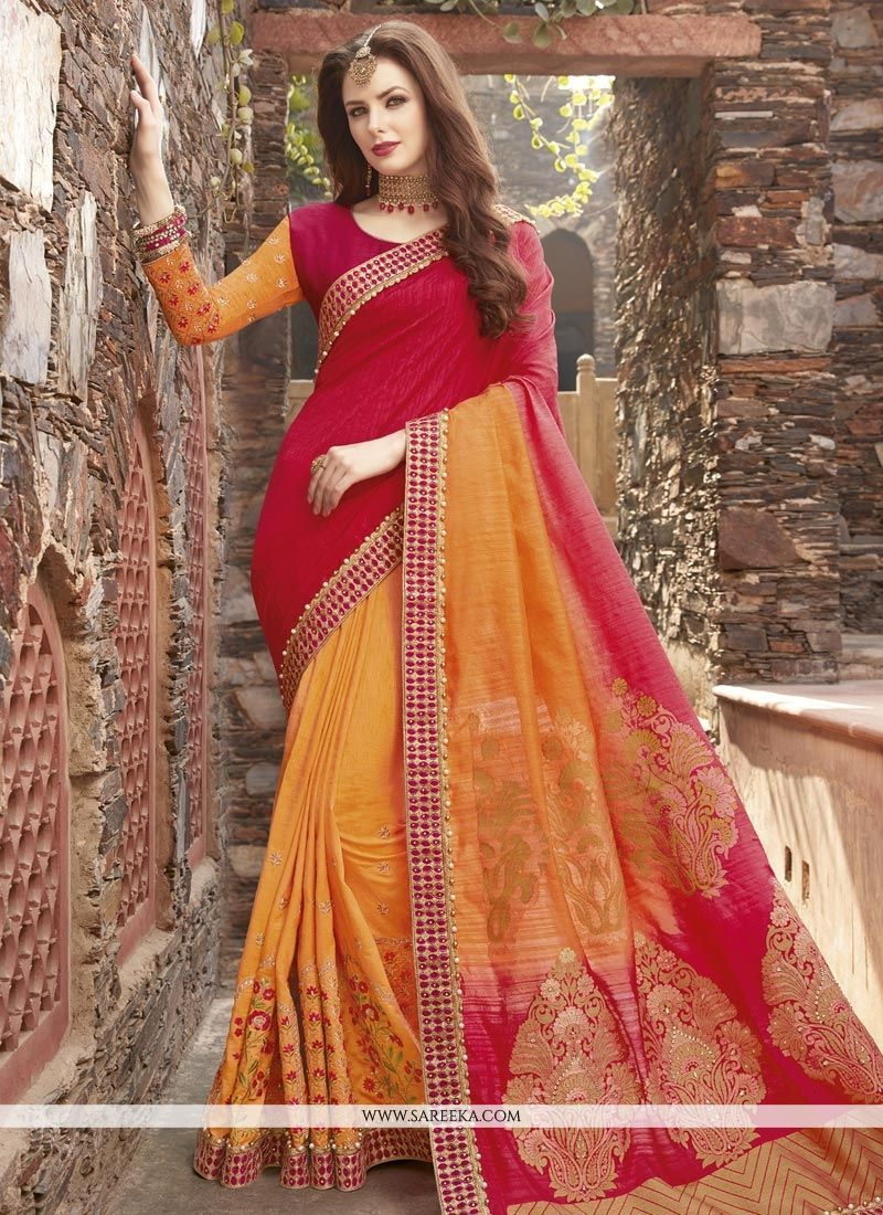 743cc6a49a Everyone will admire you when you wear this clad to elegant affairs. An  outstanding orange and red fancy fabric half n half trendy saree will make  you look ...