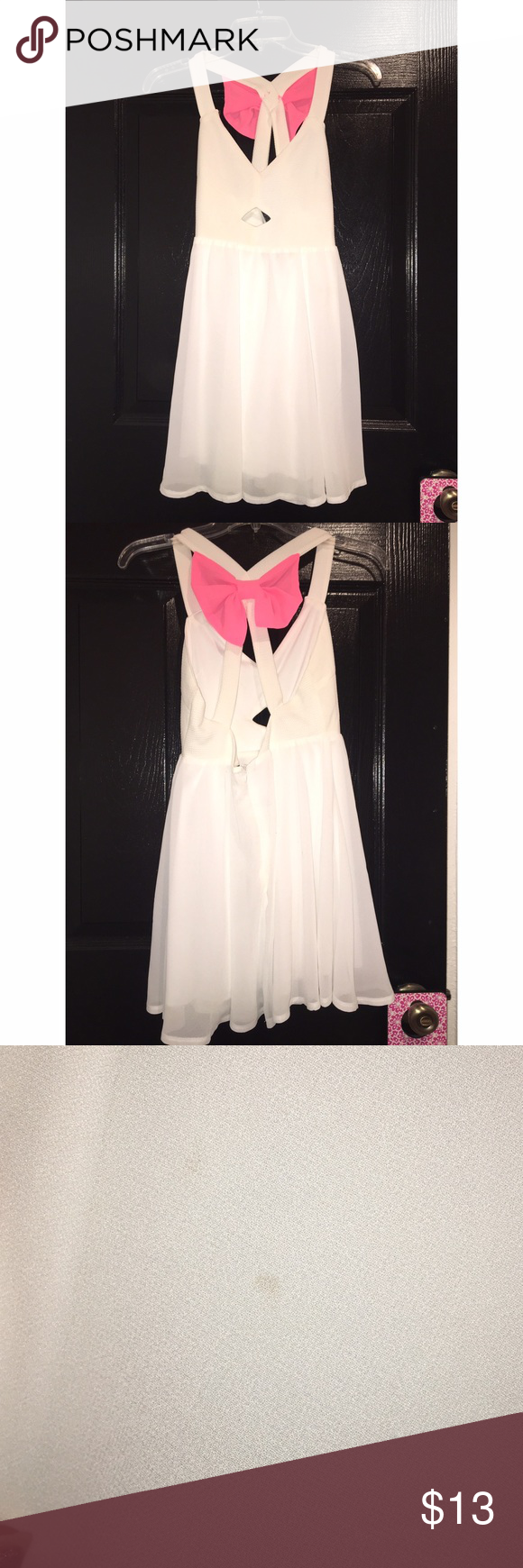Bow dress NWOT White bow dress with neon pink bow . Brand new never worn. But somehow has small small stain on back but can barely see it( smaller than pinky nail) Price FIRM since brand new Dresses Mini