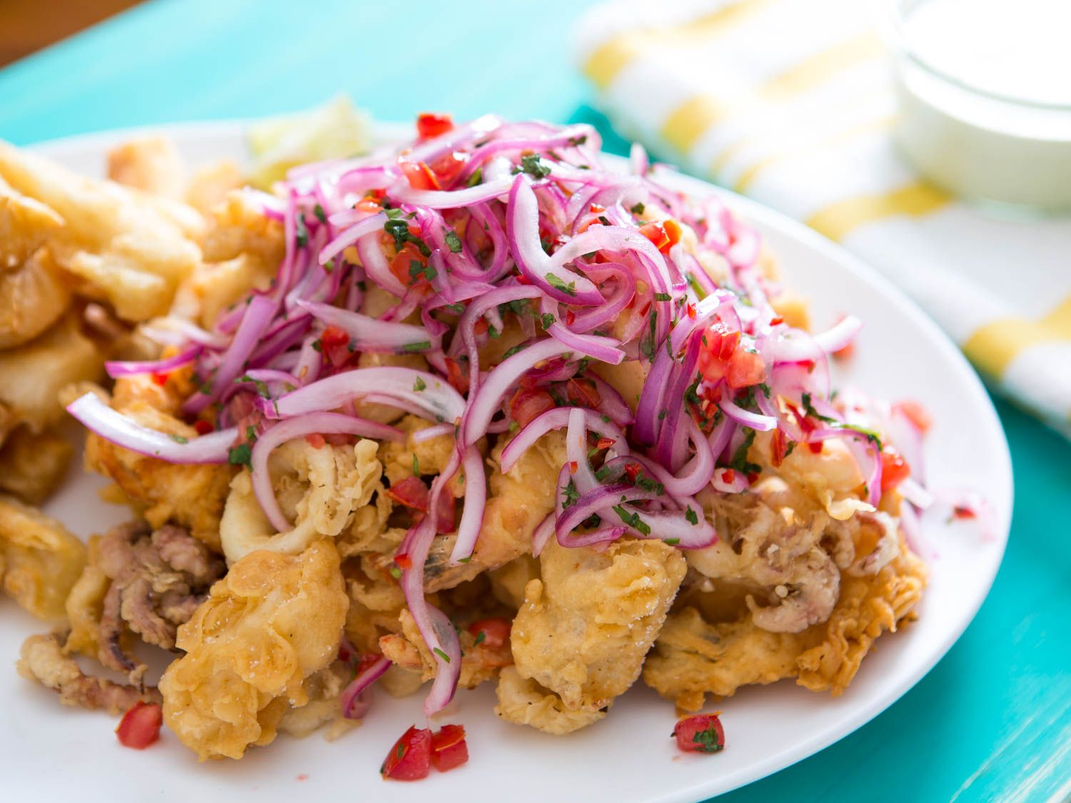 Peruvian fried seafood platter with lime marinated onion and peruvian fried seafood platter with lime marinated onion and tomato salad jalea recipe seafood platter tomato salad and onions forumfinder