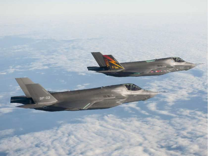 Two Lockheed Martin F-35B aircraft fly in formation on Nov. 10, 2010 at Naval Air Station Patuxent River, Md.