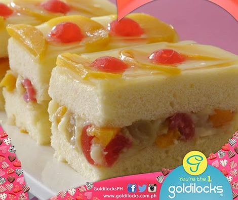It S Got A Custard Filling And Fruit Tail Combination Topped With Gelatin Sliced Peaches Cherries Fruity Fiesta In Cake