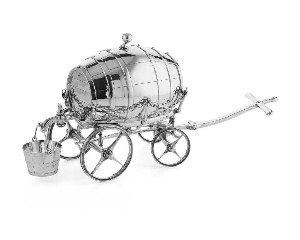 A silver brandy barrel Fenton Brothers, Sheffield 1890, the staved barrel with spigot tap, suspended pail, resting on a cradle wagon, chains to the sides, all on four spoke wheels, swivel action