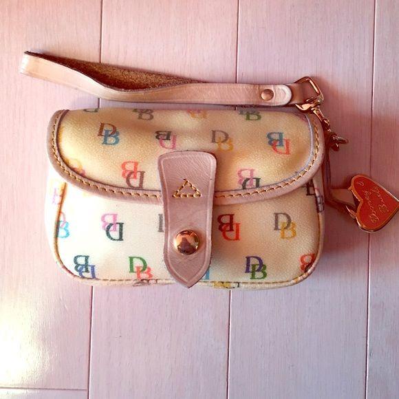 Dooney and Bourke wristlet Cream 4x6 inch wristlet Dooney & Bourke Bags Clutches & Wristlets