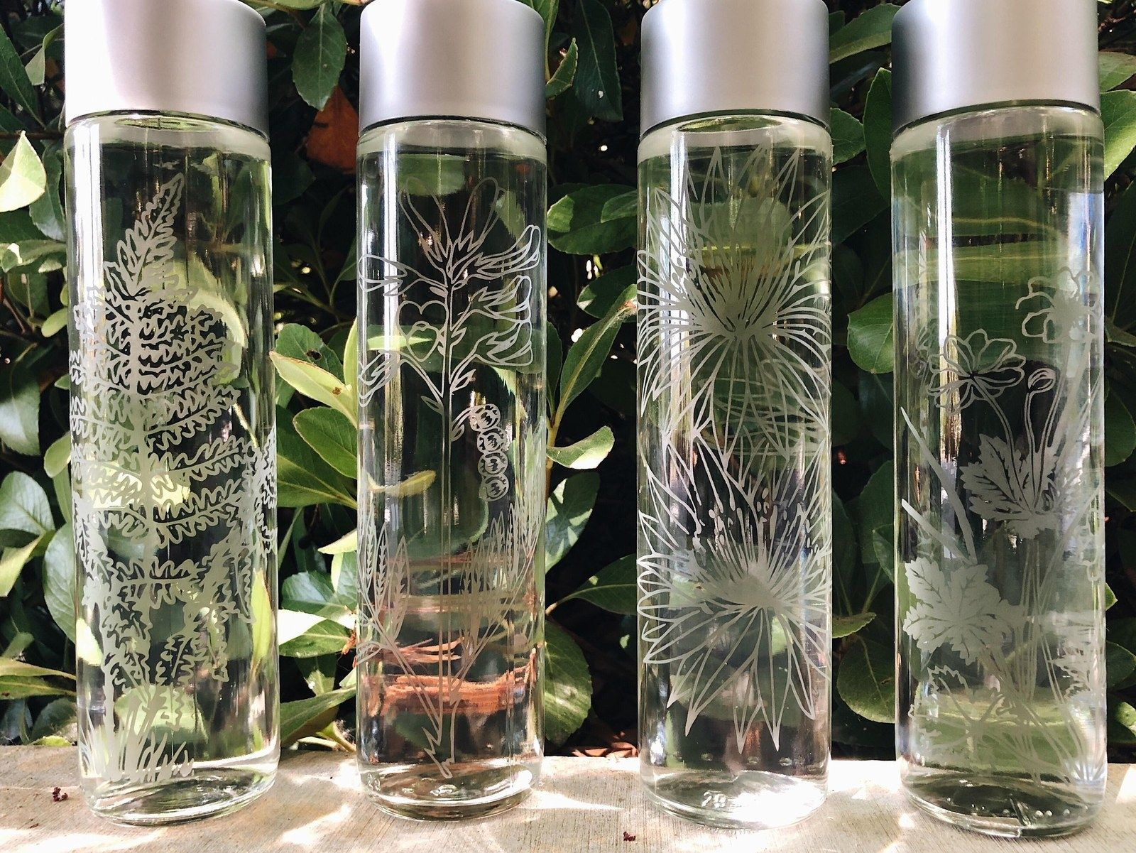 16 Pretty Water Bottles You Ll Want To Take With You Everywhere You Go Glass Water Bottle Etched Glass Water Bottles Custom Glass Etching