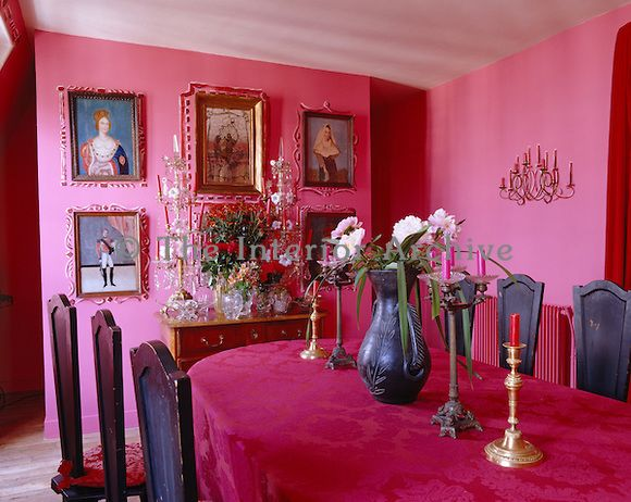 In the dining room what would otherwise be a rather sombre set of ...