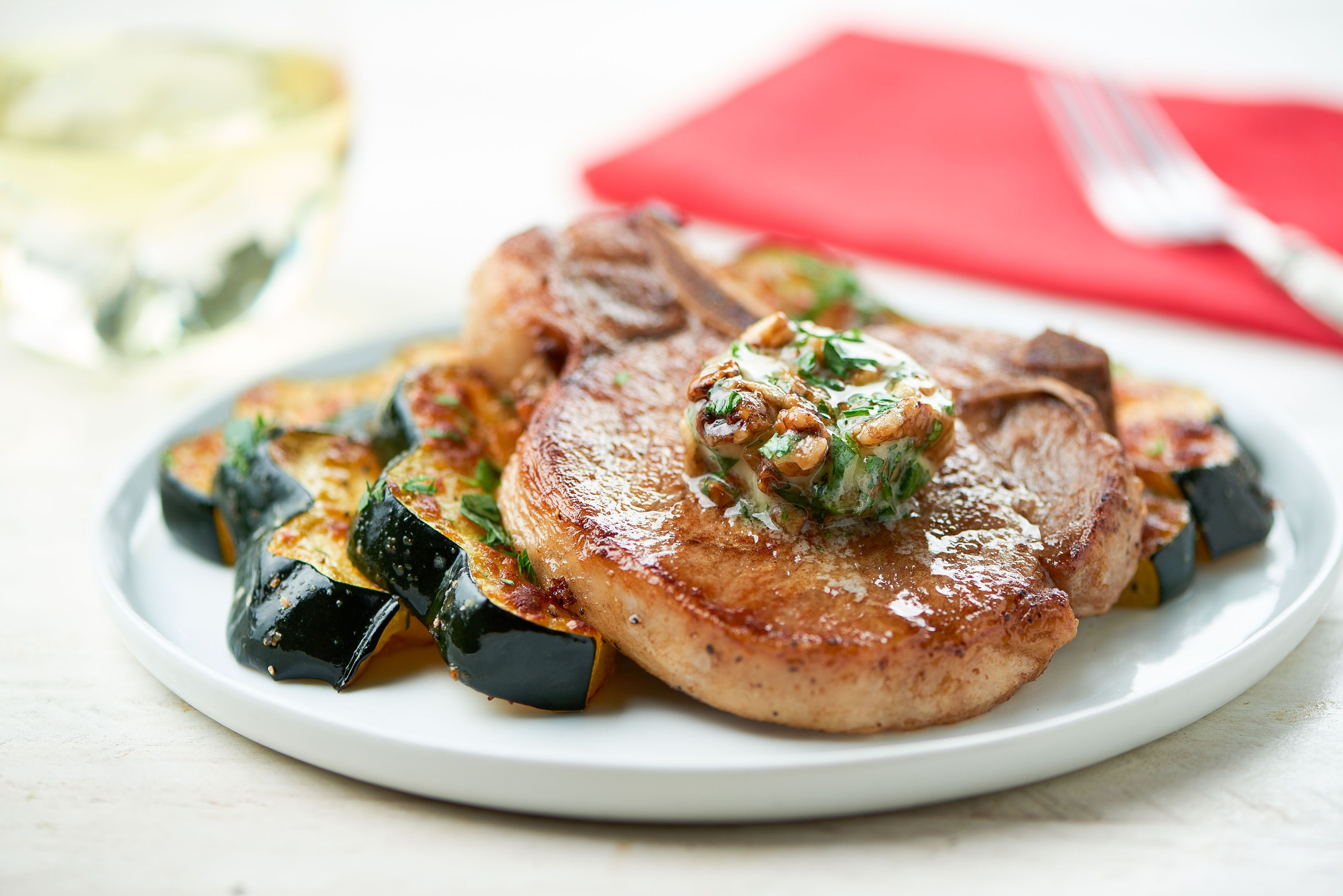 Pork Chop With Candied Walnut Butter And Parmesan Roasted Acorn