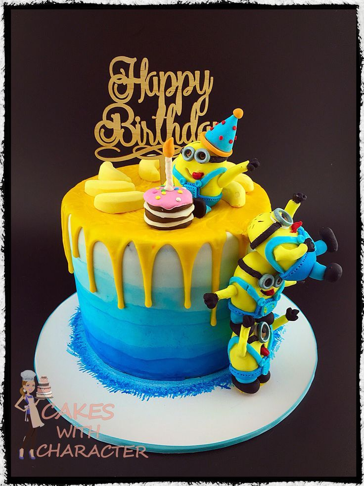 Minion birthday cake with tower of fondant minions yellow